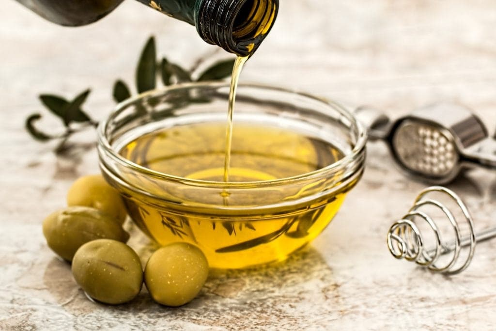 Pouring Olive Oil and olives